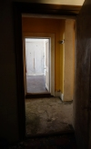 Corridor looking through to downstairs landing. Pantry off to the left