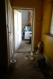 Corridor looking through to the utility room
