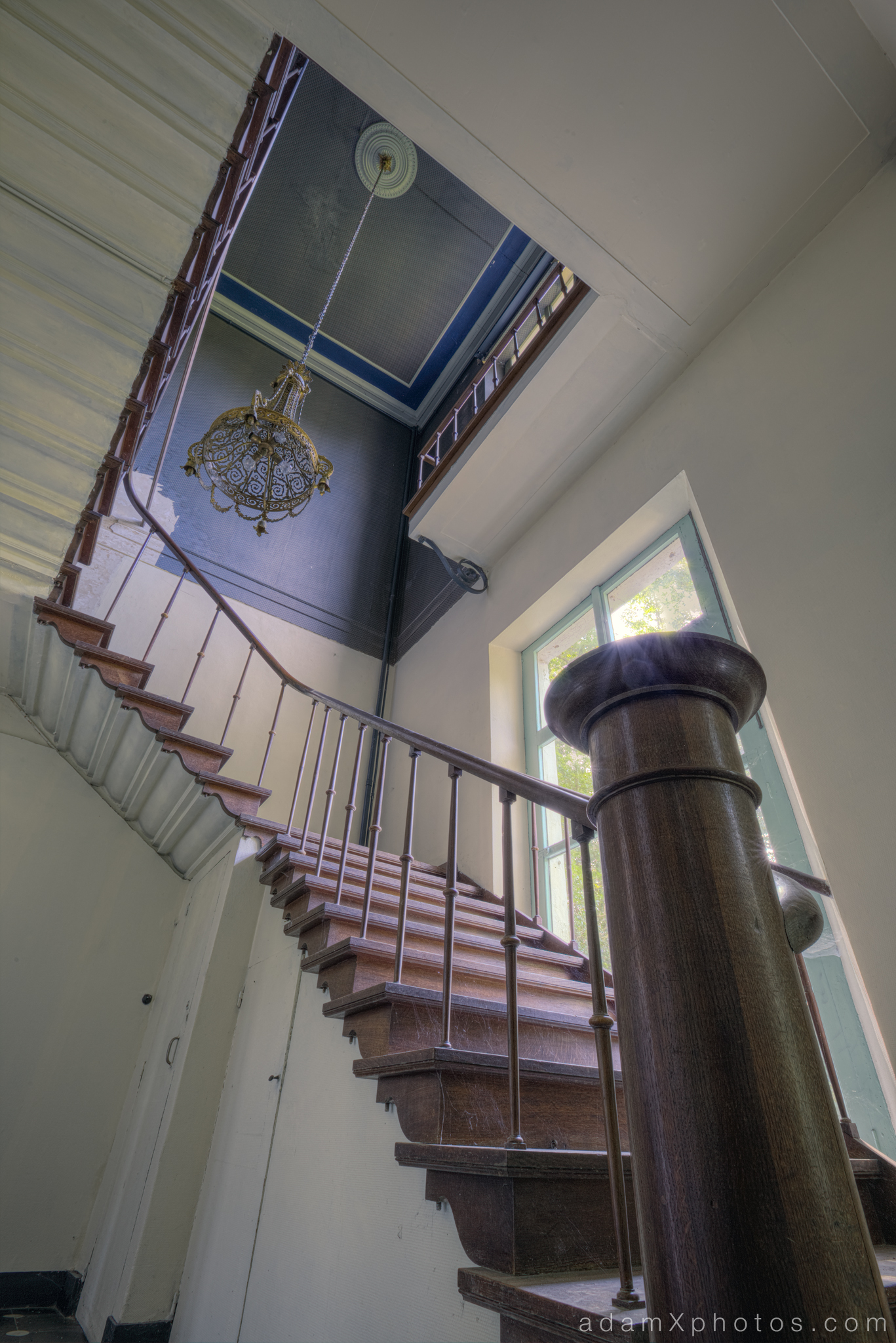 adam x chateau de la chapelle urbex urban exploration belgium abandoned stairs staircase bannisters balustrade chateau de la chapelle belgium