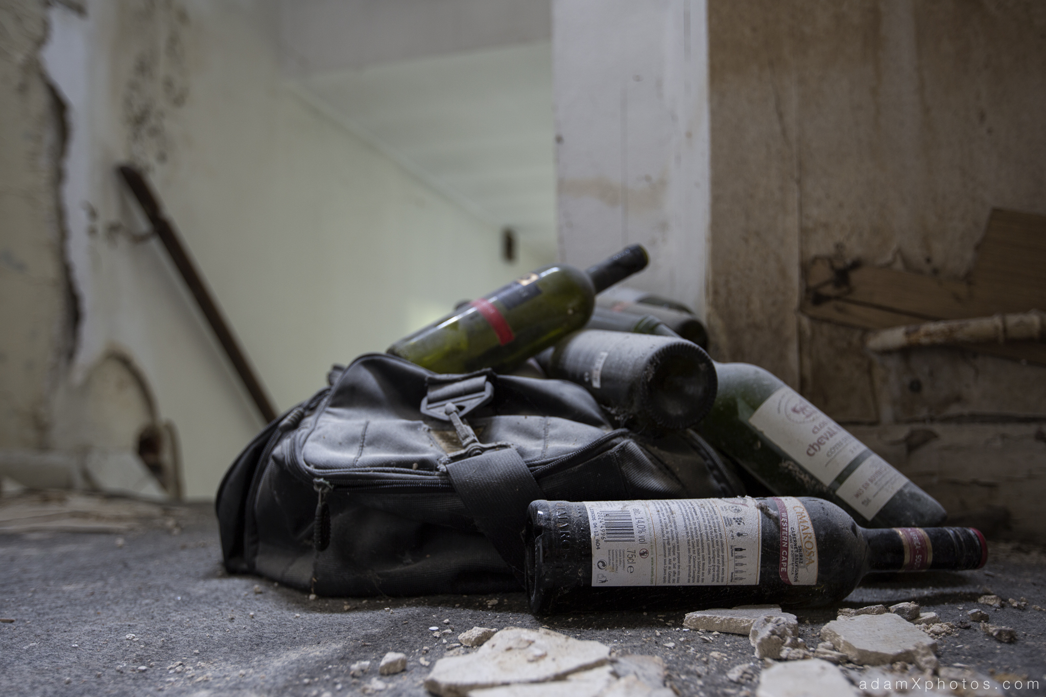 Adam X Chateau de la Chapelle urbex urban exploration belgium abandoned wine bottles dusty