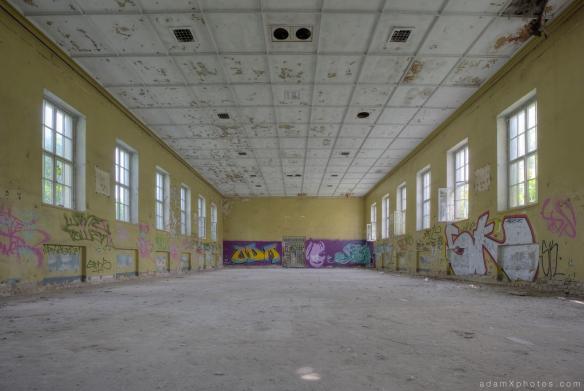 Adam X Urbex Urban Exploration Abandoned Germany Wunsdorf barracks soviet corridor large room graffiti