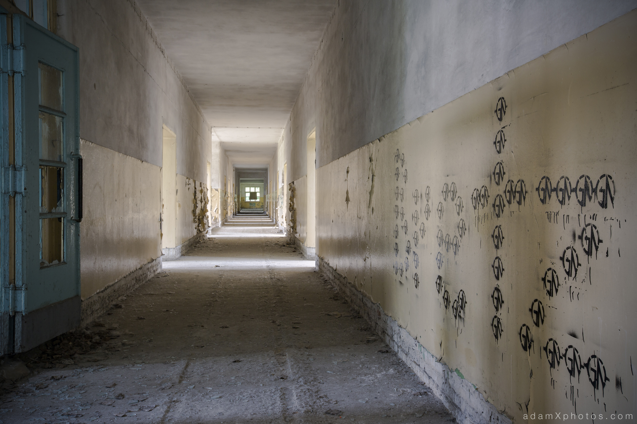 Adam X Urbex Urban Exploration Abandoned Germany Wunsdorf barracks soviet corridor decay graffiti painting blue yellow