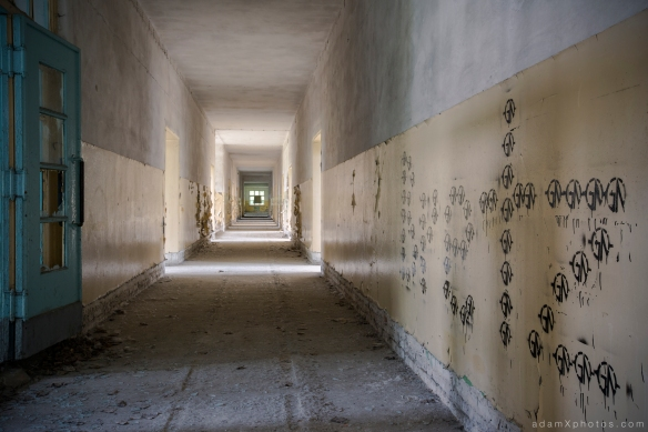 Adam X Urbex Urban Exploration Abandoned Germany Wunsdorf barracks soviet corridor decay graffiti painting blue yellow