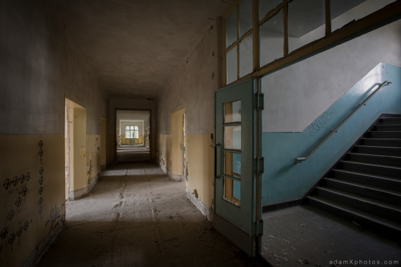 Adam X Urbex Urban Exploration Abandoned Germany Wunsdorf barracks soviet corridor stairs staircase decay colours yellow blue