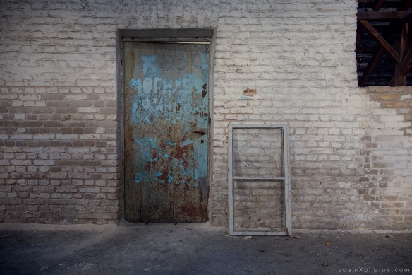 Adam X Urbex Urban Exploration Abandoned Germany Wunsdorf barracks soviet loft attic door colours blue bricks brickwork wall