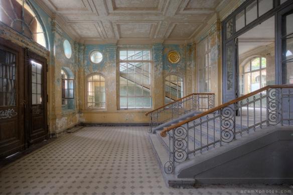 Adam X Urbex Beelitz Heilstatten Germany Urban Exploration Mens Men's Bathhouse Bath House Hospital Decay Lost Abandoned Hidden entrance hall foyer stairs