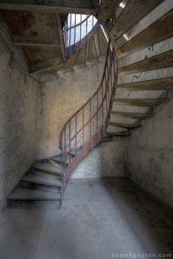 Adam X Urbex Beelitz Heilstatten Germany Urban Exploration Mens Men's Bathhouse Bath House Hospital Decay Lost Abandoned Hidden spiral stairs staircase