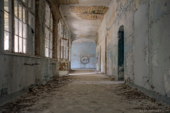 Adam X Urbex Beelitz Heilstatten Germany Urban Exploration Mens Men's Sanatorium Hospital Decay Lost Abandoned Hidden corridor moon face mural art graffiti painting paint peeling