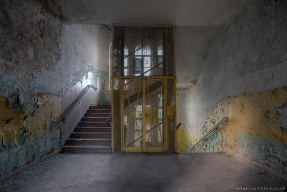 Adam X Urbex Heilstatten Hohenlychen Germany Urban Exploration Decay Lost Abandoned Hidden lift staircase ornate windows peeling paint colours sanatorium