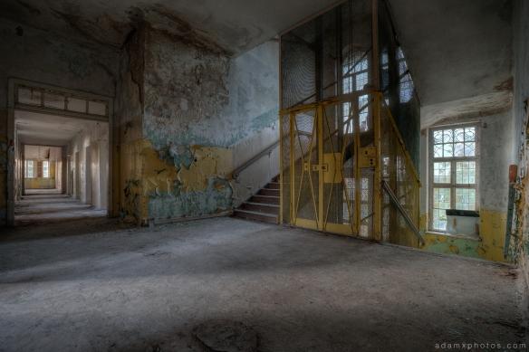 Adam X Urbex Heilstatten Hohenlychen Germany Urban Exploration Decay Lost Abandoned Hidden lift staircase ornate windows peeling paint colours sanatorium corridor