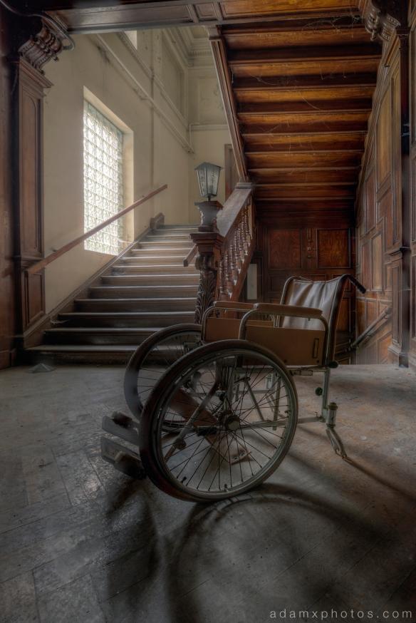 Adam X Urbex Krankenhaus von rollstuhlen Hospital of wheelchairs Germany Urban Exploration Decay Lost Abandoned Hidden Wheelchair stairs staircase wooden carved