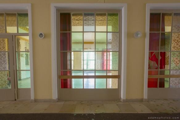 Adam X Urbex Nazi School Partishule N DDR Horsaal Germany Urban Exploration Decay Lost Abandoned coloured glass hallway lobby
