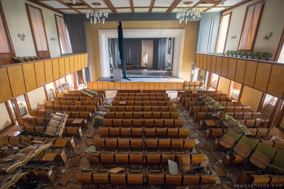 Adam X Urbex Nazi School Partishule N DDR Horsaal Germany Urban Exploration Decay Lost Abandoned auditorium ceiling seats chairs stage from above trashed