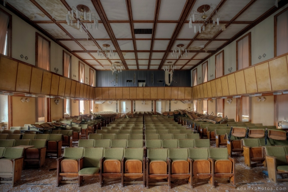 Adam X Urbex Nazi School Partishule N DDR Horsaal Germany Urban Exploration Decay Lost Abandoned auditorium ceiling seats chairs stage front view