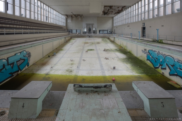 Pool from the diving blocks end Adam X Urbex UE Urban Exploration Belgium Piscine Crachoir swimming pool abandoned derelict unused empty disused decay decayed decaying grimy grime