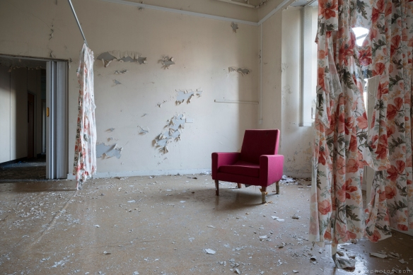 Abandoned chair and tattered curtains ward Royal Hospital Haslar Gosport History Naval Navy Military Hospital Urbex Adam X Urban Exploration Infiltration Access 2015 Abandoned decay lost forgotten derelict